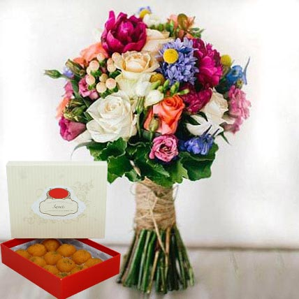 Mesmerizing Flowers and Motichoor Laddoo Combo: Flowers & Sweets
