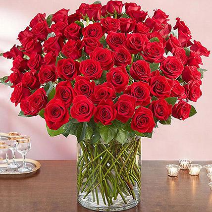 Ravishing 100 Red Roses In Glass Vase: Gifts for Husband