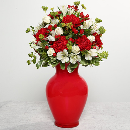 Red Carnations In Red Glass Vase: Christmas Gifts