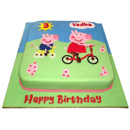 Peppa Pig on a cycle Cake: Peppa Pig Cake