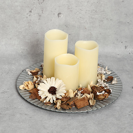 White Candles and a Plate: Diwali Candles