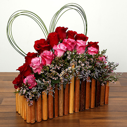 Red and Purple Roses In A Wooden Base: Valentine Flowers to Al Ain