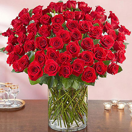 Ravishing 100 Red Roses In Glass Vase: Anniversary Gift For Husband