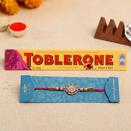American Diamond Floral Rakhi And Toblerone Chocolate: American Diamond Rakhi